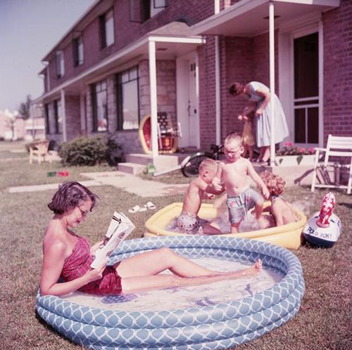Beating the summer heat in inflatable pools. #vintage #1950s #summer