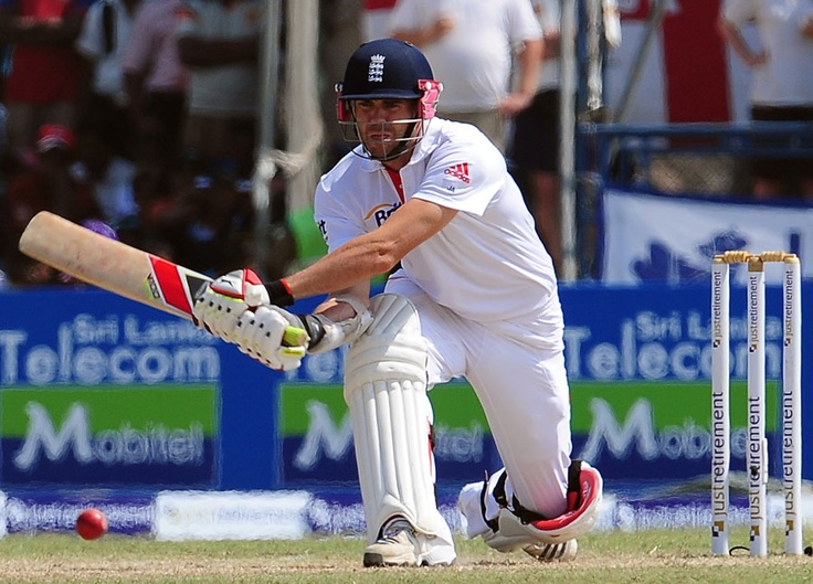 James Anderson reverse sweeps as he and Monty Panesar add 36 for the tenth wicket