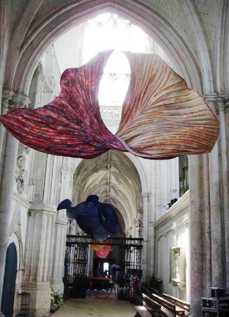 As if the ornate Gothic architecture in the Abbey church of Saint-Riquier in France wasn't beautiful enough already, it was temporarily filled with over 100 intricate and graceful paper flowers. Netherlands-based artist Peter Gentenaar created the sculptures with bamboo ribbing that echoes the curving lines of the church's vaulted ceilings.