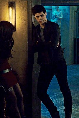 """a tol Alec Lightwood leaning against the doorframe """