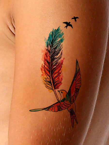 This colorful watercolor tattoo features a vibrant feather and three birds. This feather tattoo represents freedom or a decision to live freely. Available as a black or color tattoo and makes a great