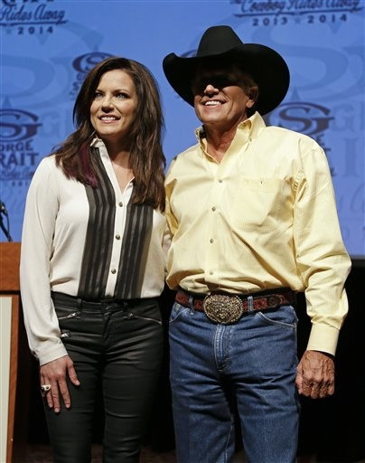 "Country music star George Strait poses with fellow performer Martina McBride after a news conference on Wednesday, Sept. 26, 2012, in Nashville, Tenn.  Strait announced his final tour, playing 21 dates in 2013 and 20 more in 2014 on The ""Cowboy Rides Away"" tour.  McBride will also be appearing on part of the tour. (AP Photo/Mark Humphrey)"