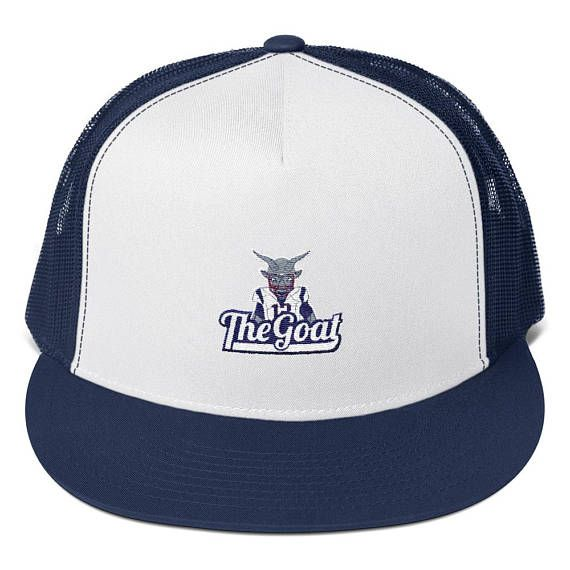This trucker hat features the Greatest Of All Time (GOAT), Tom Brady, as an actual goat dressed in New England Patriots football gear and number 12 jersey.  • 47% cotton/28% nylon/25% polyester  • Structured • Five panel  • High profile  • Flat bill  • Snapback closure