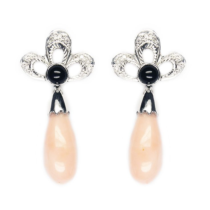 White gold earring with diamonds, onyx and coral drop.