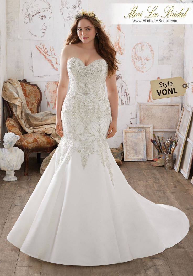 Style VONL Mischa Wedding Dress  This Duchess Satin Mermaid Wedding Dress Features Exquisite Crystal Beaded Embroidery Throughout Bodice. Corset Back Closure Ensures the Perfect Fit. Colors Available: White/Silver, Ivory/Silver. Shown in Ivory/Silver.