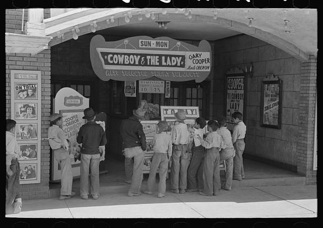 """Children in front of movie theatre, Alpine, Texas """"COWBOY & THE LADY"""" starring Gary Cooper"""