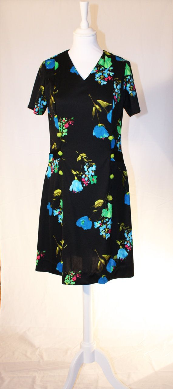 Black dress with flower print by RoxygoesRetro on Etsy, €35.00