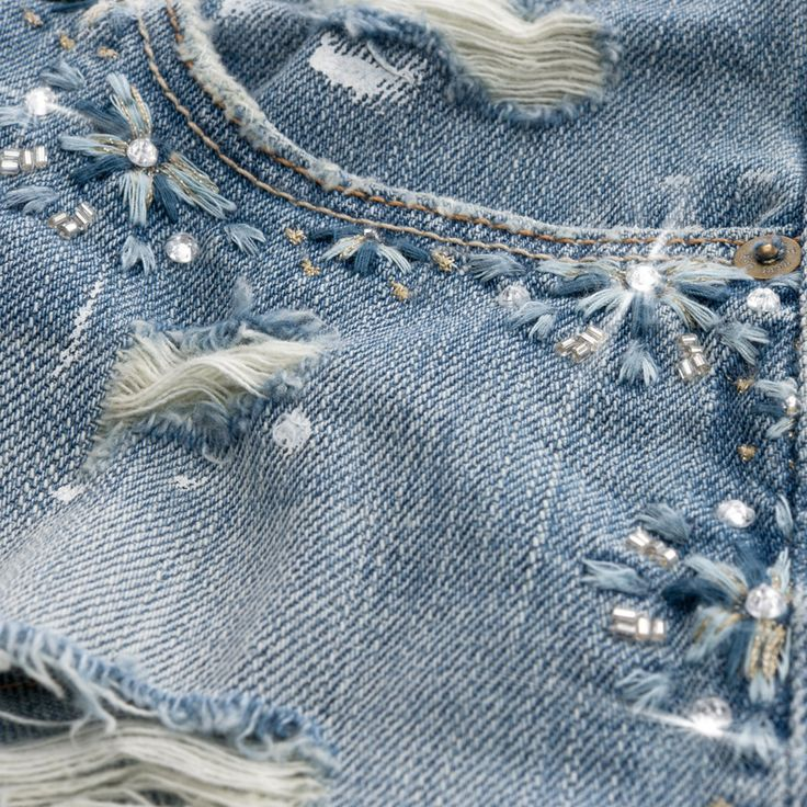 Embroidery detail on denim