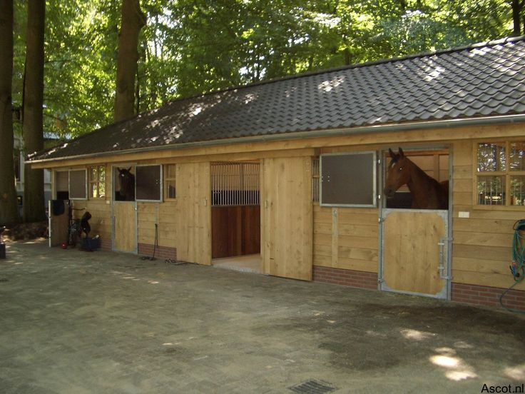 Are the stables inside or outside?  A good compact horse stabling barn, giving the best of both worlds.