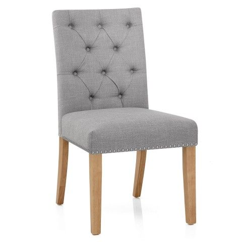 With quilted button detail, stud edging, and a chrome handle on the rear, the Barrington Oak Dining Chair Grey Fabric is a stunning piece.