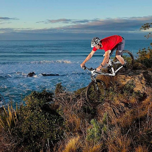 Image of the Day - Trek World Racing professional downhill racer Justin Leov, of Dunedin, NZ, picks a line in a rocky outcrop overlooking the South Pacific Ocean - Image by Derek Morrison #boxoflightnz #dunedin # #mtb #photonz #photonewzealand