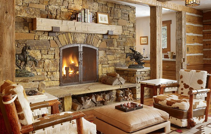 Massive stone fireplace....massive rustic reclaimed wood ...