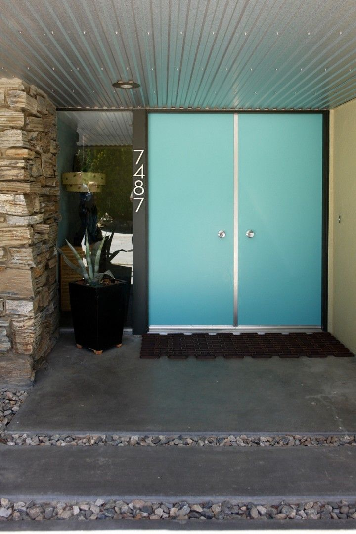 How mid-century, turquoise doors.  In love!  Secret Design Studio knows mid century modern architecture. www.secretdesignstudio.com