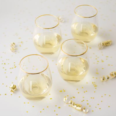 These Personalized 19.25 oz. Gold Rim Stemless Wine Glasses are perfect for elegant entertaining. Each glass features a modern-shaped bell and a gold rim. A flat bottom makes it practical enough for everyday use while adding a touch of glamour to any special occasion you host.