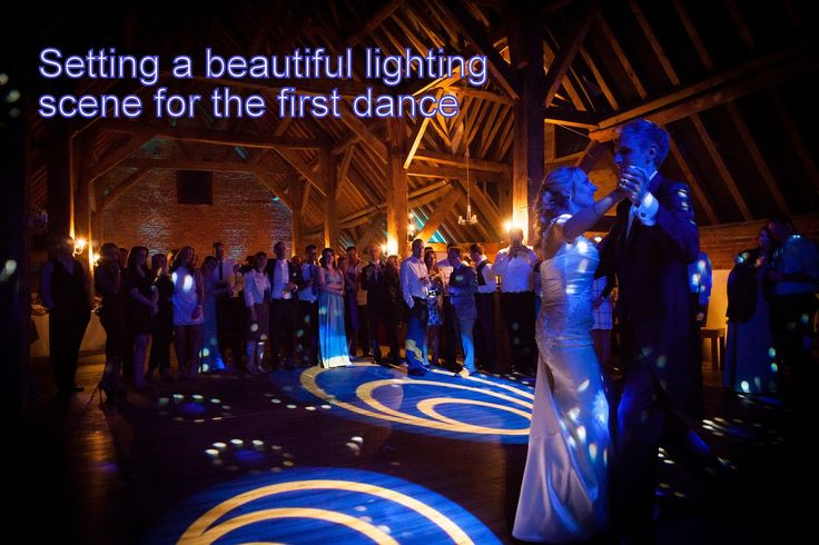 Blue gobos projected onto the dancefloor with a blue colour wash set the scene for the first dance in this stunning barn wedding at Barford Park - DJ Martin Lake