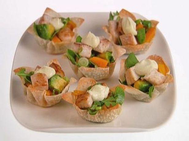 Os tacos de tilápia com rúcula é uma ótima entrada para dividir com os amigos. Chef: Giada De Laurentiis
