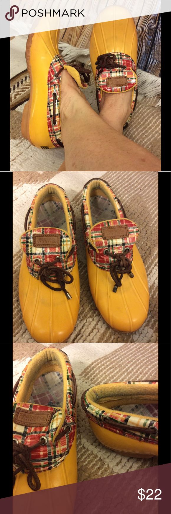 Sperry Topsider's yellow duck rain shoes size 8 Cute Sperry Topsiders yellow duck rain shoe Plaid  around upper portion of shoe Minor wear on bottom Does show wear on the inside Has dark discoloration toward front part of toe as shown in pictures Length from heel to toe approximately 10 1/4 inches  width of shoe is approximately 4 inches Leather shoe string Super cute and still have plenty of life left Sperry Top-Sider Shoes Winter & Rain Boots