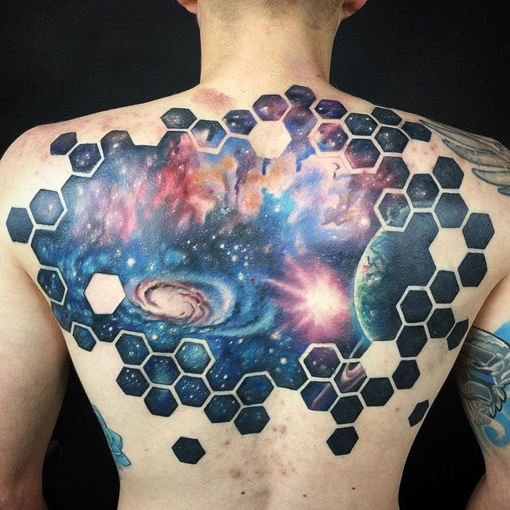 TATTO IDEAS & INSPIRATIONS Space scene on guy's back with the Earth, a galaxy and interstellar clouds, surrounded by hexagons. Tattoo by Daniel Claes