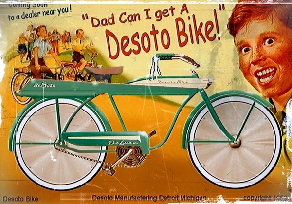 1959 De Soto bicycle ad.  The kid looks a little psycho...