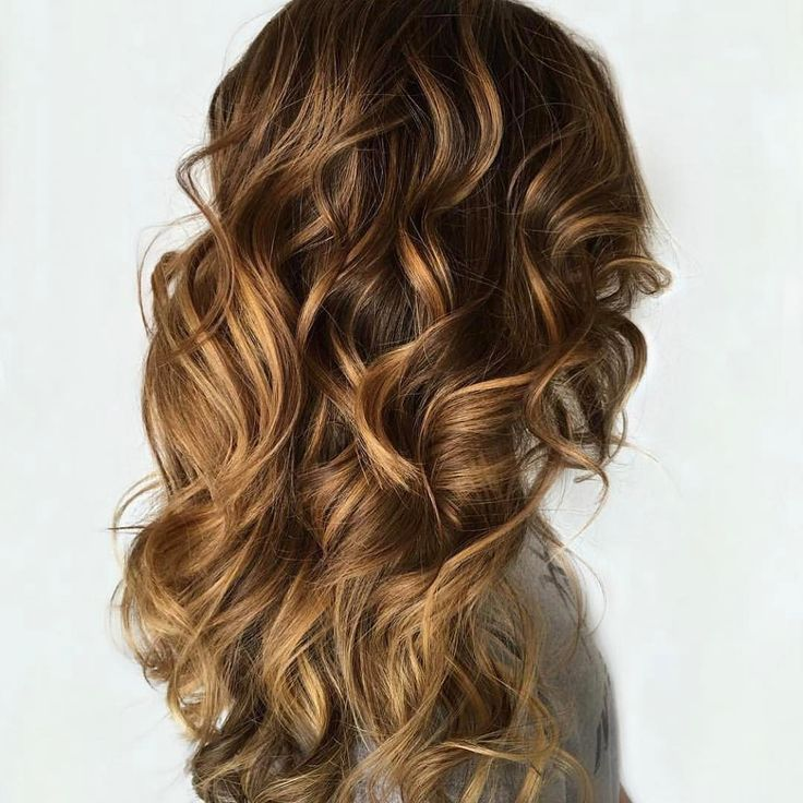 We are totally crushin' on these loose #curls and #balayage for #WCW. A gorgeous mane like this is sure to catch the eye of your #crush!  What or who have you been crushing on lately?  TAG #usmooth for a chance to be featured on our account!