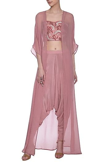 4ed8a3852c Poshpride Featuring a shalom pink bustier in silk crepe base with embroidery.  It is paired with matching dhoti pants and cape in silk georgette base.