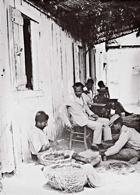 1927 ~ Nikos Kazantzakis in Corinth, with fishermen