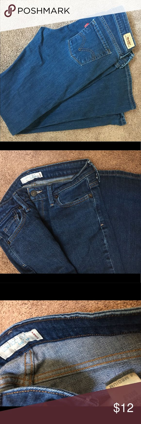 women's Levi jeans Medium wash Levi 511 low rise boot cut jeans. No frayed edges at the bottom and barely any wear!! Levi's Jeans