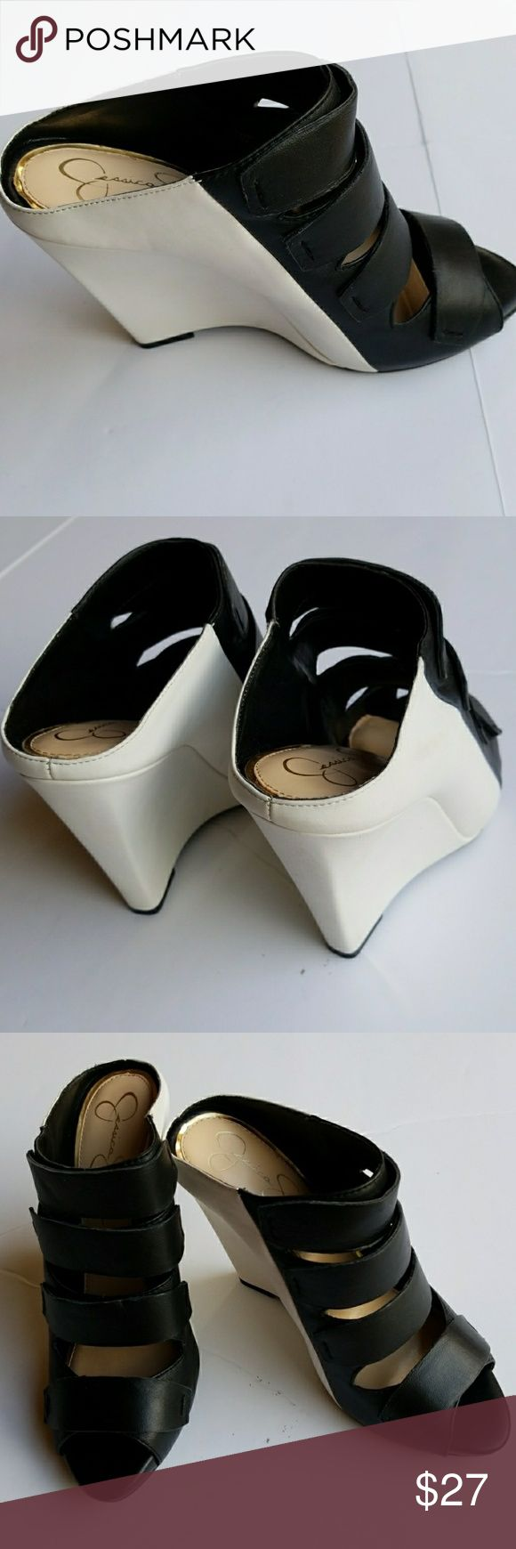 """Jessica Simpson  black/ white wedge shoes size 8 Chic black and white  shoes.  New store display . Heel 4.5"""" Leather/man made upper.   Add my closet to your favorite for new arrivals. I add new items to my closet every week.  ❌No trading. ❌ No lowballing ✔Offers through offer button only.  Reasonable offers please  Jessica Simpson Shoes Wedges"""