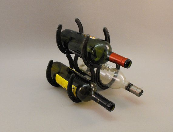 Metal wine rack made from horse shoes