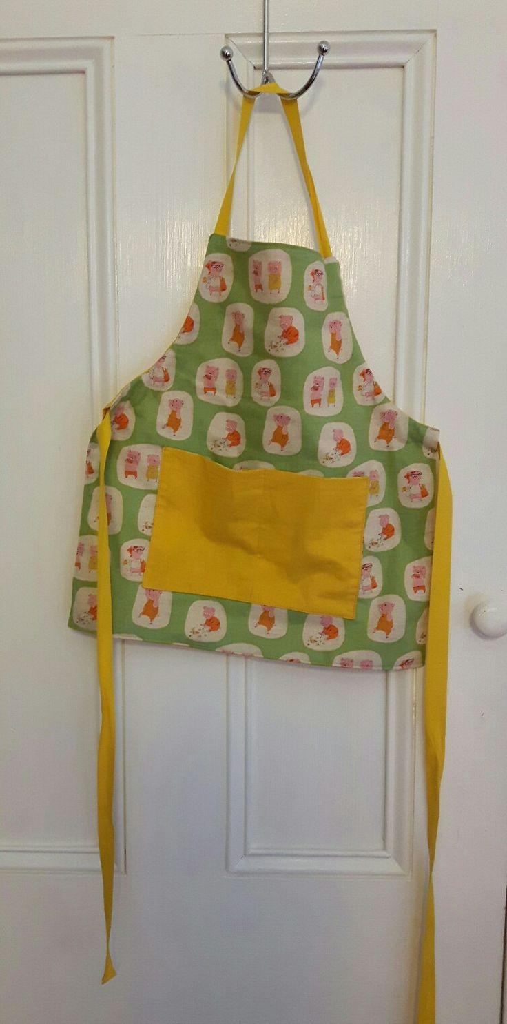 Reversible baby apron. Kokka cotton, solid yellow cotton. All stash. 2m cotton webbing, £1.20. Using up scraps, hurray!