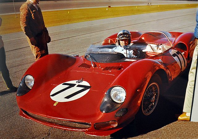 Pedro Rodriguez at Daytona 1965    This is the 1965 Daytona 2000 Km. In the NART Ferrari 330 P2 is Pedro Rodriguez. who is adjusting his rear view mirror. The car would fail to finish due to a busted rear axle. His co-driver was John Surtees. DIS photo courtesy of Ormond Beach Memorial Museum.