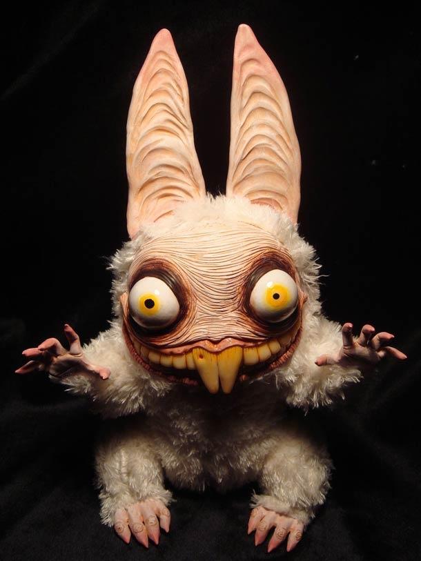 This is my idea of cute.  Creepy plush dolls by Santani.