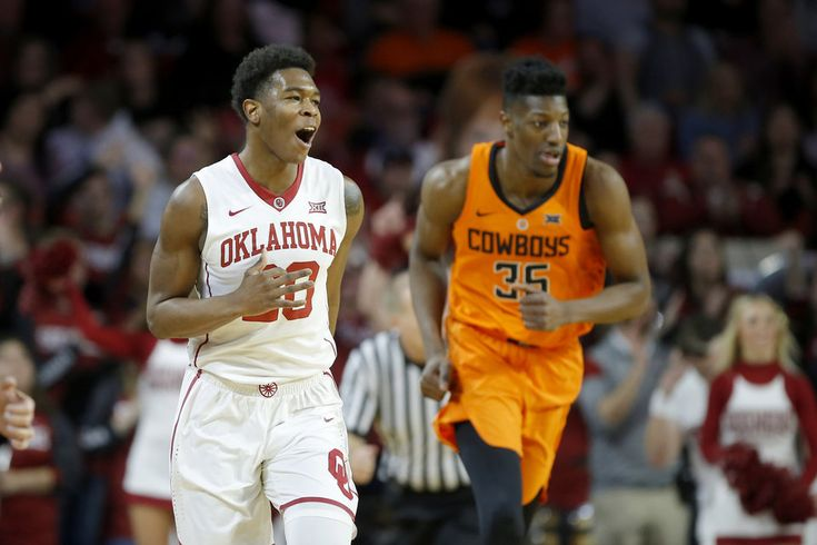Oklahoma's Kameron McGusty (20) celebrates beside Oklahoma State's Yankuba Sima (35) after making a 3-pointer during a Bedlam basketball game between the Oklahoma Sooners (OU) and the Oklahoma State Cowboys (OSU) at Lloyd Noble Center in Norman, Okla., Wednesday, Jan. 3, 2018. Photo by Bryan Terry, The Oklahoman
