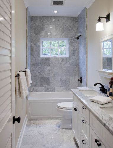 Narrow bathroom benefits from shower window to break up the space and provide fresh air.