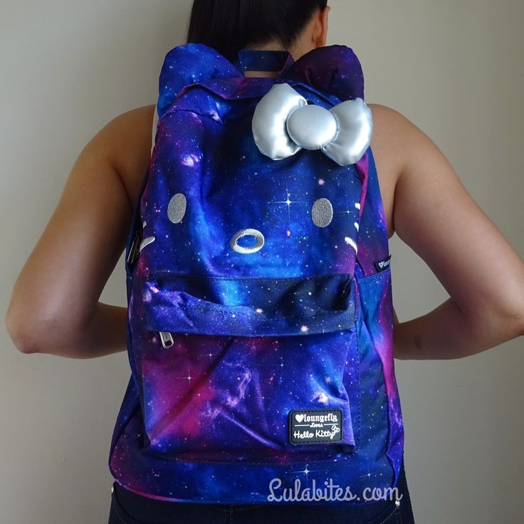 This Hello Kitty backpack is out of this world, cute! It comes with a silver 3D bow, adjustable straps, zip front pocket and a laptop sleeve on the inside. Material is printed nylon and measures W:11.