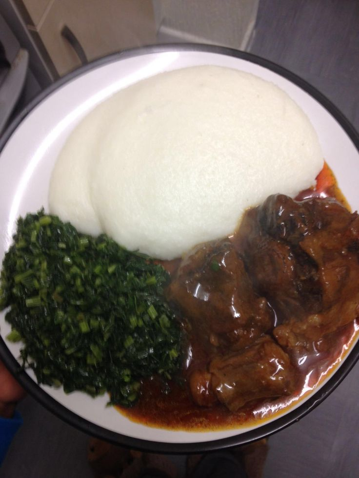 Special African meal. #sadza, oxtail stew and green fried vegetables