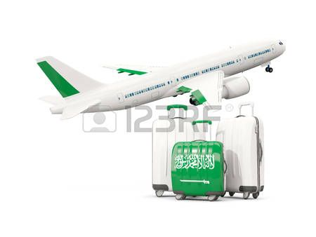 Luggage with flag of Saudi Arabia. Three bags with airplane isolated on white. 3D illustration photo