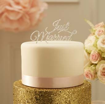 """Top your special wedding cake with this stunning silver sparkle """"Just Married"""" cake topper."""