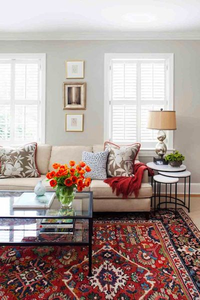 Transitional living room with oriental rug, custom textiles and nesting tables.
