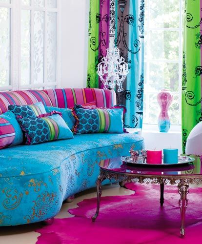 modern sofa with blue velvet burnout on the bottom with bold pink stripes on the back
