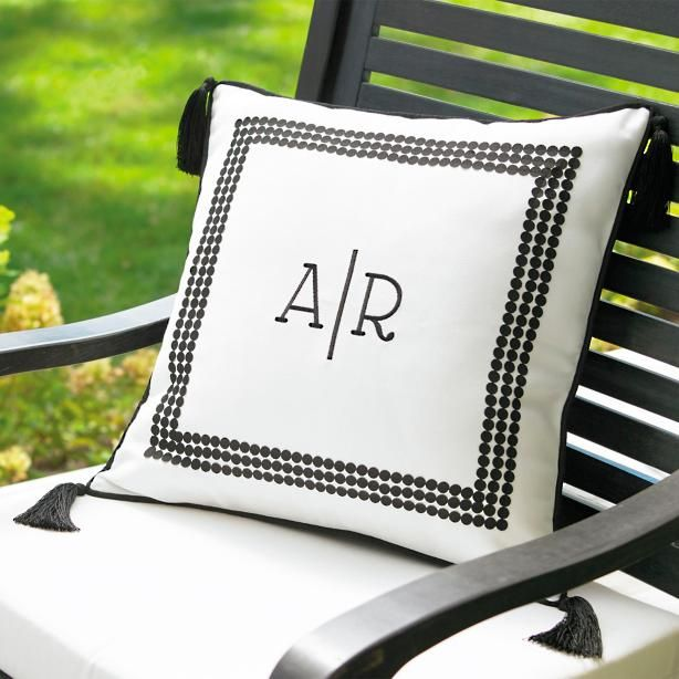Remind everyone who hosts the best open-air gatherings with our classically designed and perfectly personal Emery Monogrammed Outdoor Pillow. There no denying personalized pieces hold a place in your home (and heart) that anything less special simply can duplicate. Classic white ground is embellished with a distinctive checked border that frames your choice of four monogram styles and three fonts (personalization on us!). Back is a matching solid, and tonal tassels give this toss pillow real…