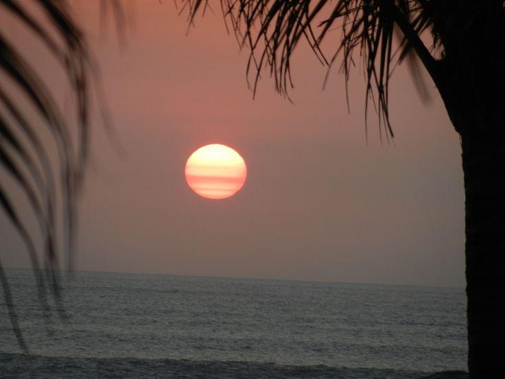 Sun setting over Beach near Seminyak, Bali.