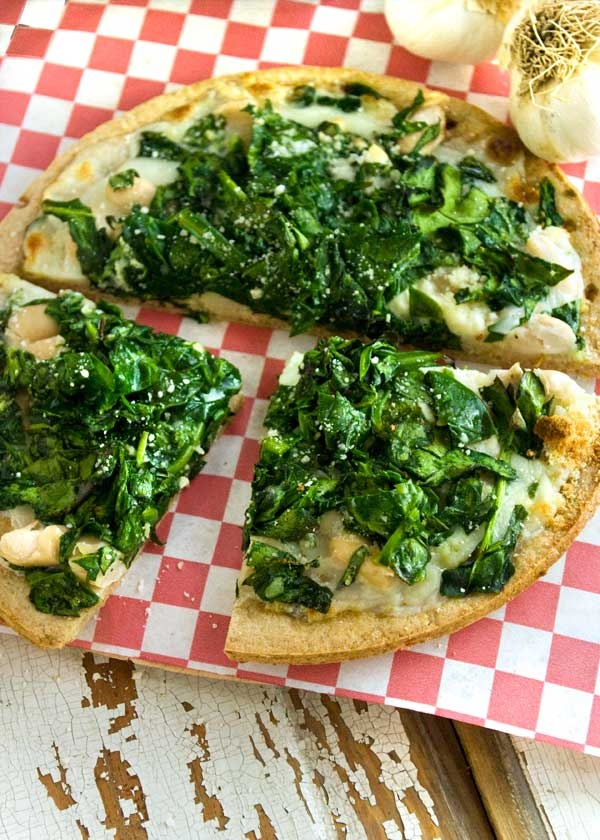 Yum! Spinach and white bean pizza recipe. Too tasty not to try.