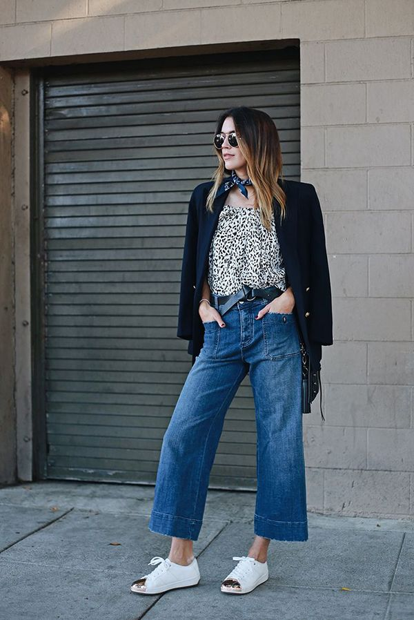 Cropped jeans are paired with a printed top, blazer, bandana, and cap-toe sneakers