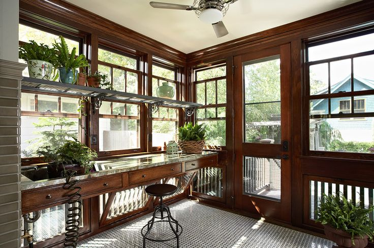 Low hopper windows. This potting room addition to a 1919 bungalow includes classic double-hung windows above a potting bench and inward-opening hopper windows below. The lower windows allow for extra air circulation in the room, which aids plant growth … and they look stunning!
