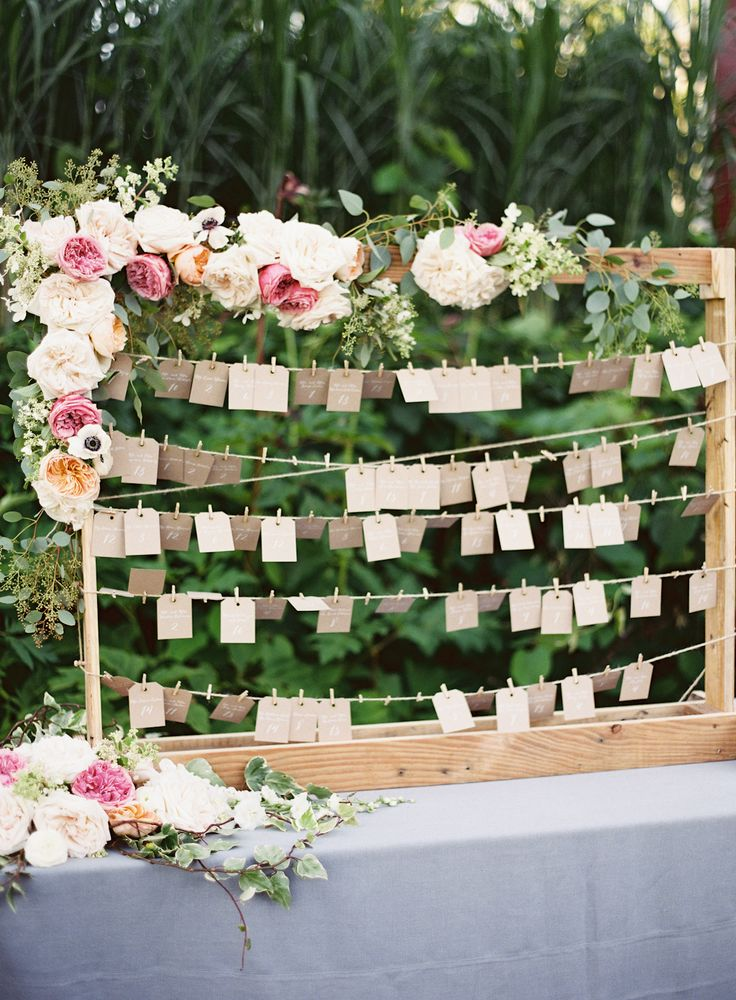 hanging escort card table design with floral accents