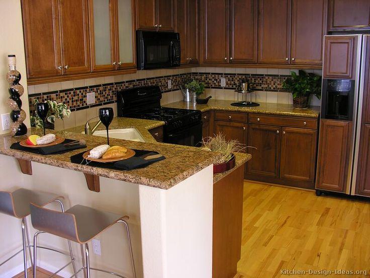 #Kitchen Idea of the Day: Dark Golden-Brown Kitchen with black appliances.