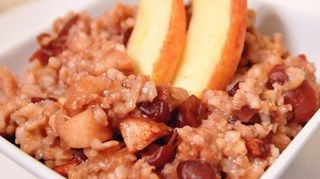 Delicious cinnamon-apple oats cook slowly all night in the slow cooker, and are ready for a hot breakfast the next morning.