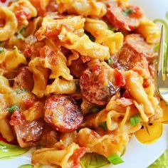 Spicy Sausage Pasta: this was DELICIOUS! I loved that it all cooked in one skillet (no water to boil for pasta, no casserole dish to wash--so practical and awesome). Perfect flavor balance of spicy and creamy. I used mozzarella cheese because it was what I had