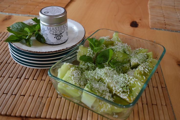 #Matcha is great to sprinkle on almost any dish as a finishing garnish!  This photo: Sliced melon with grated coconut and DoMatcha sprinkled on top. Topped with a sprig of fresh mint.  www.domatcha.com